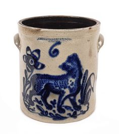 "Sold For $ 6,000   Six-gallon stoneware crock, 19th c., impressed F. Stetzenmeyer & Co. Rochester N.Y., with vibrant cobalt decoration of a lion, 14'' h.                            Condition report           3"" and 1"" hairlines at rim. 1/8"" flake to rim. Provenance: Lots 1-155, the Collection of Jack & Mary Louise Krumrine, Philadelphia, PA."