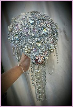 """Custom made Full brooch Bouquet This bouquet is a larger sized wedding bouquet at 9"""", which is approx 28"""" in circumference. All made and fully covered with all quality stunning brooches and gems. Cust"""