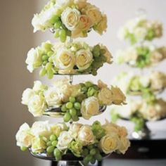 Do cupcake tiers with grapes and flowers for decor on the food table.  Edible decor!