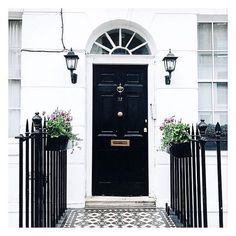 Black & white- imposing but correct. Space Architecture, Architecture Details, Door Knockers, Door Knobs, When One Door Closes, Rustic Backdrop, House Front, Curb Appeal, Entrance