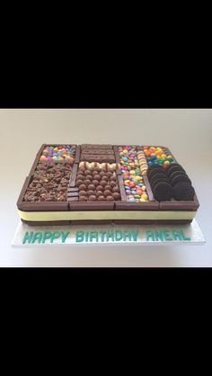 Fresh cream and cookies Kitkat cake, topped with assorted chocolates.