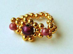 Bague dorée en perles : Bague par lesbijouxdunibou