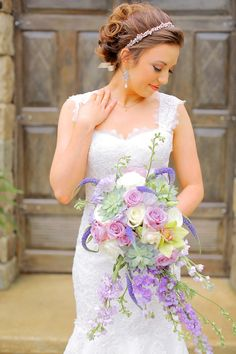 Whimsical cascading bouquet with lavender and succulents.