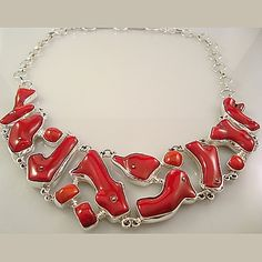 A unique statement piece, this floating necklace made from natural red coral & 950 silver.