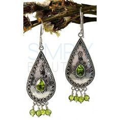 Green Dangle Peridot and Sterling Silver Earrings - A pear shaped antiqued silver plate is adorned with small polished silver beads in a zigzag design. Four green beads hang down from the bottom and a pear shaped facet cut green peridot accents the center of the silver plate.  http://simplybeautiful2012.com/green-dangle-peridot-and-sterling-silver-earrings.html#