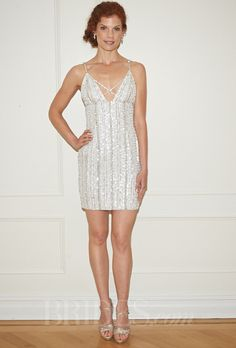Brides.com: Randi Rahm - Fall 2014. Short beaded sheath wedding dress with v-neckline and spaghetti straps, Randi Rahm