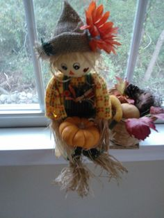 Small scare crow girl filled with fall pickings