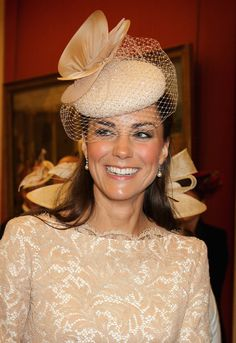 Two receptions and a royal feast in splendid surroundings - Duchess of Cambridge, her fascinator up close.