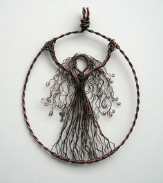 https://flic.kr/p/a4b5xd | Wire Goddess | Well, here she is - my interpretation of a goddess, depicted in wire.  I so wanted the leaves twining around her, but I really think it looks better without.  Copper wire, oxidised.