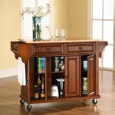 Crosley Kitchen Cart / Island with Natural Wood Top in Classic Cherry