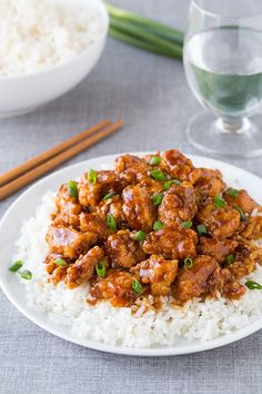 General Tso's Chicken on top of white rice on dinner plate