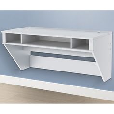 Constructed from laminated composite wood, this sturdy SOHO white floating desk from Prepac uses a hanging rail system to keep it securely mounted to the wall. Its sleek, straight lines and compact de