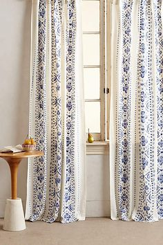 Available in red or blue....on sale plus and extra 30% off.  Printed Lyndley Curtain - anthropologie.com