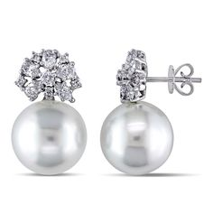 These glamorous one of a kind earrings from the Miadora Collection feature 12-13 mm south sea pearls and 22 round white diamonds. This classic pair is set in 18-karat white gold and are secured with b