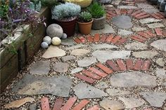 Any local friends looking to get rid of bricks or old stepping stones? I would love to do an artistic patio mosaic! My front yard has a stone garden wall made from an old building in Washington.