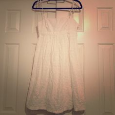 FINAL MARKDOWN ‼️ White eyelet Gap sundress Size 8, white eyelet Gap brand sundress. Adjustable tie straps, tighter around the bust, loose fit around bottom. Perfect for graduations, parties, family events. Dress is a few years old but only worn a few times and in like new condition! More pictures upon request or make an offer!!  no trades. GAP Dresses Midi