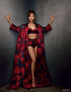 Beyoncé lives her life in front of cameras—the paparazzi's as well as those of her own attendant videographers. Rochas flower-print silk-satin opera coat, sculpted bra, and high-waisted shorts.