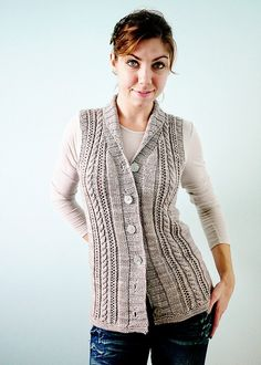A beautiful cable and lace vest with a close shawl collar for keeping out the cold. A great layering piece for any wardrobe, Gamine does casual or dressy. An engaging knit, without too much fuss, this vest will be ready to wear in no time. Ravelry, Knit Vest Pattern, Lace Vest, Dress Gloves, Work Tops, Madame, Knit Cardigan, Knitwear, Knitting Patterns