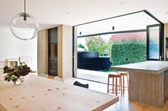 Bifold doors and windows open the living spaces to the outdoors.