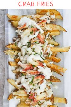 Crab Fries - with Fresh OR Canned Crab Meat - Champagne Tastes - Learn how to make crab fries! These baked fries are loaded with cheese, garlic yogurt sauce, green onions or chives, and are an easy seafood appetizer or game day side dish. Seafood Appetizers, Seafood Dishes, Appetizer Recipes, Dinner Recipes, Crab Appetizer, Seafood Pasta, Party Appetizers, Seafood Nachos, Crab Dishes