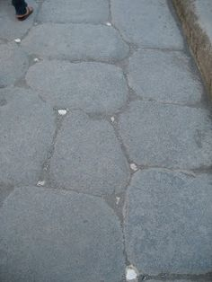 Road in Pompeii.  The small white pieces of marble reflects in the dark allowing you to see the road at night.