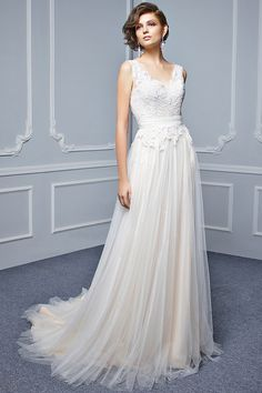 Wedding Dress out of Beautiful (BT17 28)Style BT17-28 Feminine, flowy, and oh-so-soft -- this full-length, A-line gown has all the makings of a picture-perfect bridal style. A sweetheart neckline on a corded lace bodice is ultra-romantic coupled with a dreamy tulle skirt with a