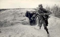 Angolan and Cuban soldiers deploy into action from their bunker in Angola. Precise date and exact location unknown.