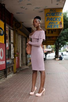 One day I would like to have this much poise and confidence. And also that dress, and those shoes. And maybe those killer legs. On the Street……Downtown, Johannesburg, SA | The Sartorialist