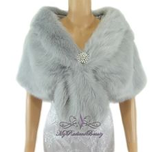 Our Silver Grey faux fur Stole; perfect matching for any color dresses.. this is a must have for your wedding dresses, Evening dresses, Prom dresses... or any special event that you are attending. you get the Luxuries style from this beautiful Silver fur without sacrificing the life of our animal. We also offer this in the color of white, Ivory, Plum, Grey Chinchilla, Champagne, Vintage Brown, Brown Chinchilla, Navy Blue and Black. Beautiful and Elegant Silver Grey Faux Fur in Stole…