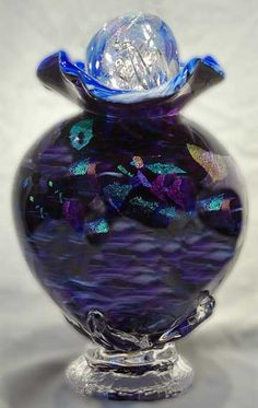 All cremation urns are hand blown, starting with the melting of the sand,  which comes from the very mother earth that supports our lives.  All cremation urns are signed and dated by the artist, and can be personally inscribed.