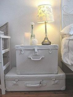 old suitcases painted white for bedroom decorating