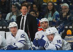 Head coach Mike Babcock, Patrick Marleau #12, Nazem Kadri #43 and Mitchell Marner #16 of the Toronto Maple Leafs watch during a 5-3 loss to the Buffalo Sabres in an NHL game on March 5, 2018 at KeyBank Center in Buffalo, New York.