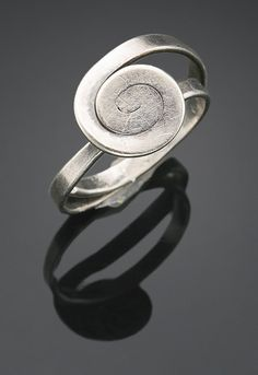 Alexander Calder 1898 - 1976 RING silver wire 5/8 by 1/2 by 1/4 in. 1.6 by 1.3 by 0.6 cm.