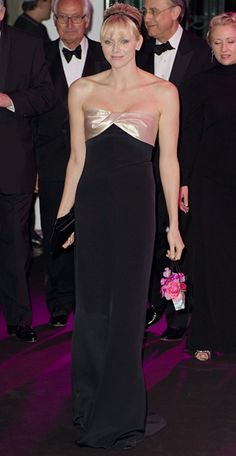 March 24, 2012Princess Charlene of Monaco attended the Swinging London Monaco Rose Ball in a strapless black gown with a beige silk bodice. She styled her hair in a bouffant updo accented with a thin black headband.