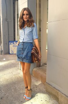 denim on denim + oversized clutch + turquoise/black ankle strap heels