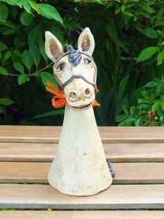 http://de.dawanda.com/product/63387427-Pferd-Pony-Zaunhocker-Gartenfigur-Gartenkeramik