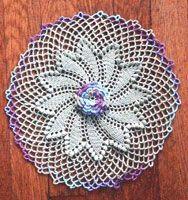http://www.crochetmemories.com/blog/spiraled-elegance-doily/