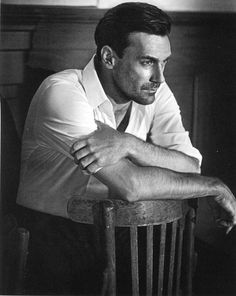 Love the idea of a backwards chair and leaning on it.  Jon Hamm