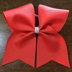 Learn how to make a perfect cheer bow with our step-by-step easy to follow instructions. We'll show you all the tricks to get a professional result every time! http://www.hair-hardware.com/how-to-make-cheer-bows