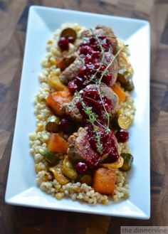 Balsamic marinated pork tenderloin, roasted balsamic vegetables on a bed of harvest grains with cranberry-cabernet compote.