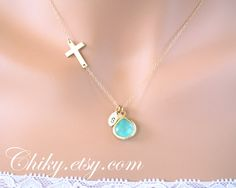 So cute.   Sideways cross necklace with initial leafs and stone in by chiky, $42.00