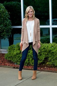 I love the way the drapey cardigan plays against the super skinny jegging cut of the jean. Id totally wear this outfit with this styling. Love it.: