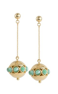 Dangling green and gold earrings.