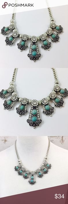 Turquoise Statement Necklace Rhinestones Silver Statement necklace in turquoise, Rhinestones, and a dose if gorgeous! Measures 18 inches long plus it has an extension. Drop on front is 2 inches. Silver tone metal. Gift box included. Jewelry Necklaces