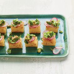Using prepared polenta makes really fast work of these hors d'oeuvres, which get piled with a fresh, crunchy little salad.