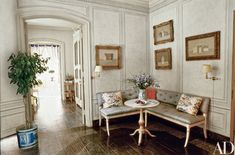 Giorgio Morandi still lifes cluster over a parcel-gilt banquette at Bunny and Paul Mellon's Manhattan residence, a 1966 French Provincial–style townhouse by architect H. Page Cross; it was decorated with Paul Leonard, William Strom, John Fowler, Bruce Budd, and others.