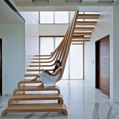 """Waves of wood form this staircase at SDM Apartment by Arquitectura en Movimiento #architecture #design #stairs #interior #designdautore"""