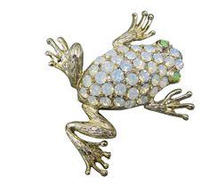 For a truly fun accessory with a touch of whimsy this adorable vintage brooch is a stunning golden frog with a shimmering rhinestone back and green eyes.