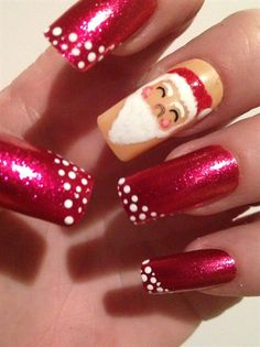 Cute pair of Santa Claus Christmas nails. Perfect for Christmas party or a day out shopping with your friends!  Check out more designs on FDL nails.com.