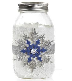 SUPPLIES & TOOLS:  1 Mason jar White tissue paper, cut into manageable squares Mod Podge® Paintbrush DecoArt Glistening Snow Stickless Glitter Glue, desired colors Silver ribbon Glue Scissors